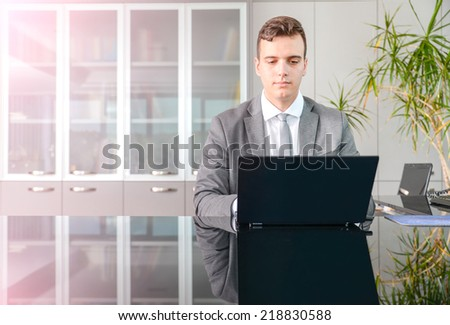 Business man working on computer desk - stock photo
