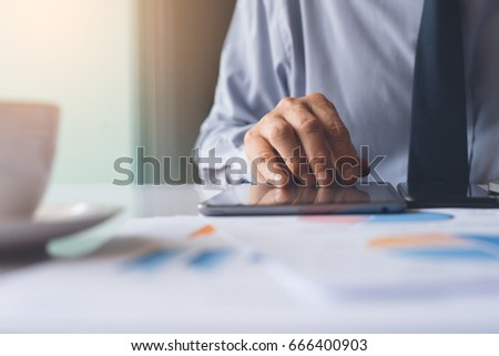 Business man working on digital devices, digital tablet, smart phone and laptop computer analysis business data, information review, business strategy analysis concept
