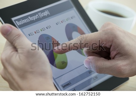 business man working on digital tablet at office - stock photo