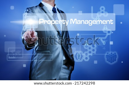 Business man working on digital virtual screen press on button property management - stock photo