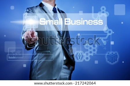 Business man working on digital virtual screen press on button small business - stock photo