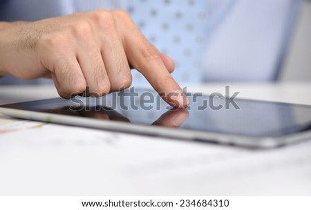business man working on his digital tablet computer close up