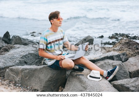 Business man working on the beach with a laptop