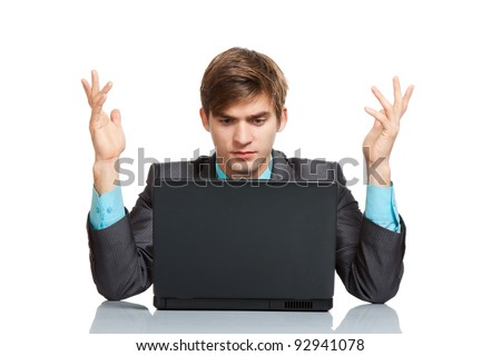 business man working problem using laptop looking at screen hold hands up, businessman sitting at the desk, isolated over white background, computer virus or error concept - stock photo