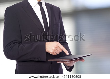 Business man working with a digital tablet at the office