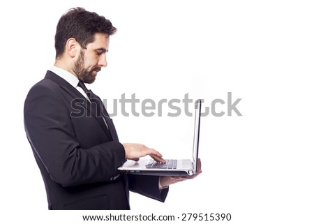Business man working with a laptop computer, isolated on a white background - stock photo