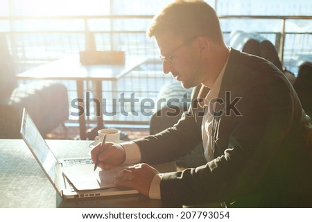 business man working with documents and laptop  - stock photo