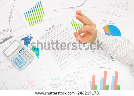 Business man working with financial data - OK sign - stock photo