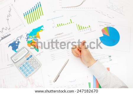 Business man working with financial data - ready to sing contract - thumb up - stock photo