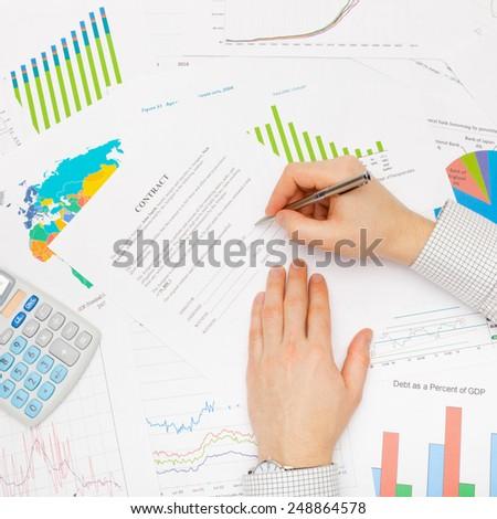 Business man working with financial data - studio shot - stock photo