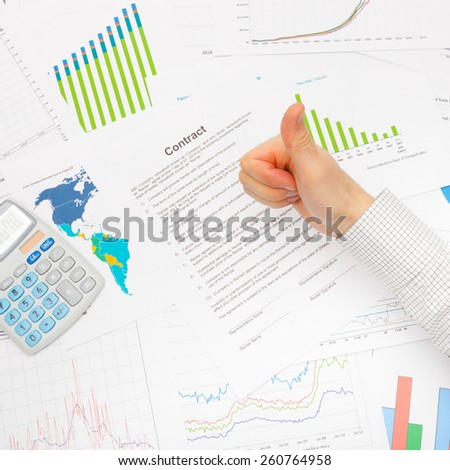 Business man working with financial data - thumb up - studio shot - stock photo