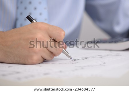 business man working with financial documents close up