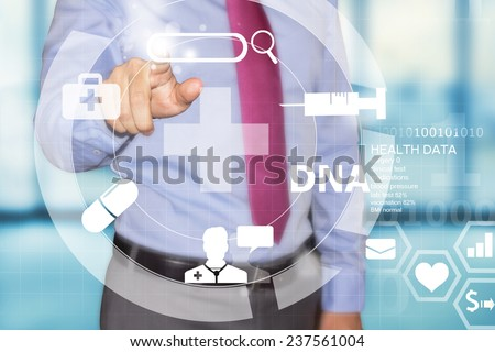 business man working with futuristic medical interface - stock photo