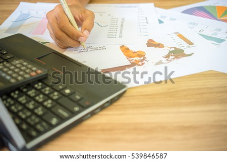 business man working with graphs and charts.