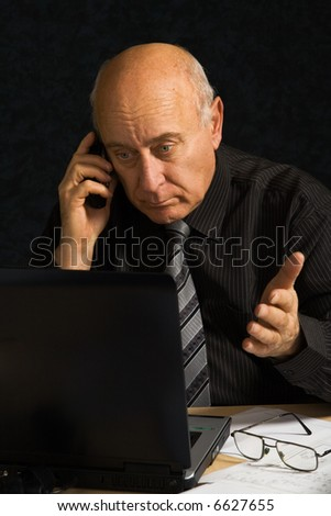 Business man works on his laptop - stock photo