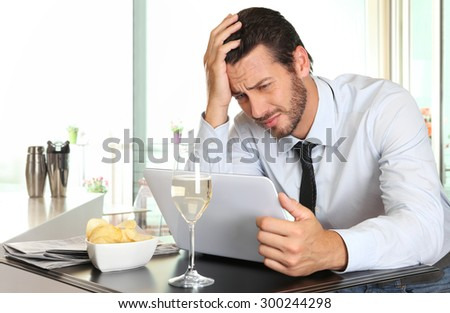 business man worried by the bad financial news - stock photo
