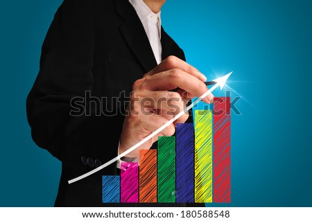 business man write over achievement bar chart or graph - stock photo