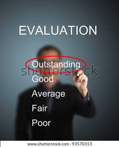 business man write red mark at outstanding choice on evaluation survey form - stock photo