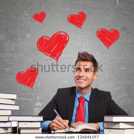 business man writing a love letter at his office desk