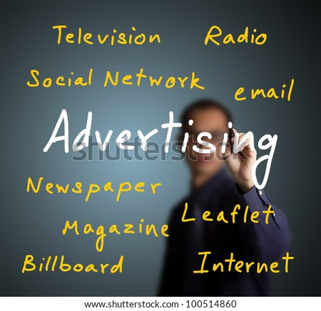 business man writing advertising concept with various media type - stock photo
