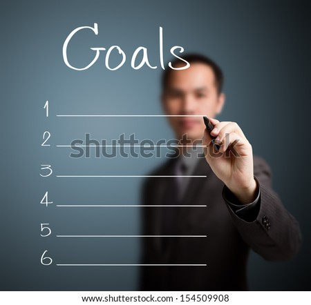 business man writing blank goal list