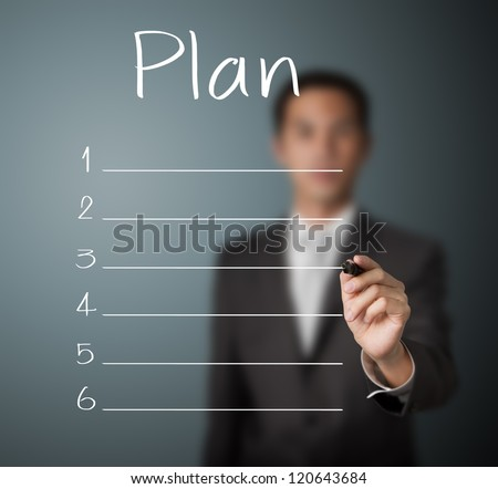 business man writing blank plan list