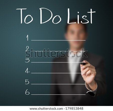 business man writing blank to do list