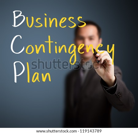 business man writing business contingency plan
