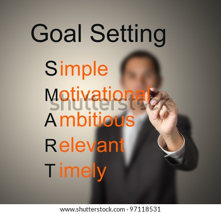 business man writing  concept of smart goal or objective setting - simple - motivational - ambitious - relevant - timely - stock photo