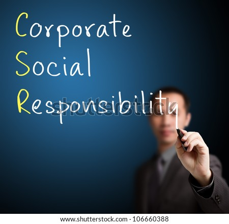 business man writing corporate social responsibility ( CSR ) concept - stock photo