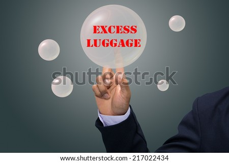 business man writing EXCESS LUGGAGE concept - stock photo