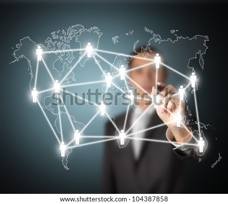 business man writing global social network or people management connection diagram - stock photo