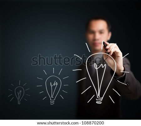 business man writing growth light bulb - development symbol of think, idea, innovation, solution, creative, vision, smart - stock photo
