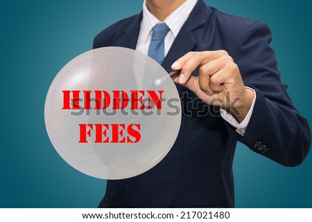 business man writing HIDDEN FEES concept - stock photo
