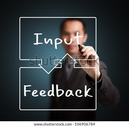 business man writing input and feedback exchange concept - stock photo