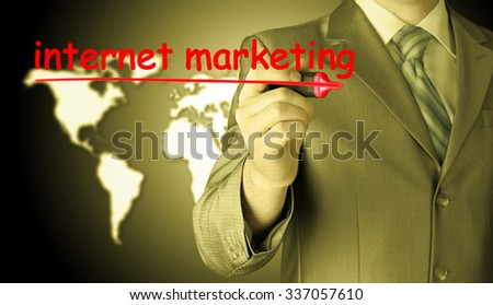 business man writing internet marketing