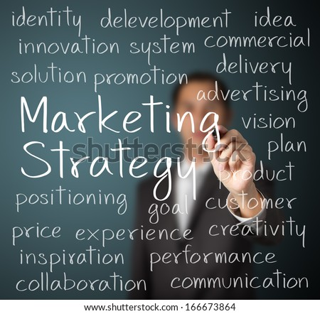 business man writing marketing strategy concept - stock photo