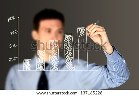 Business man writing on a board - stock photo