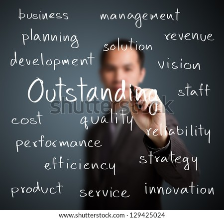 business man writing outstanding concept - stock photo