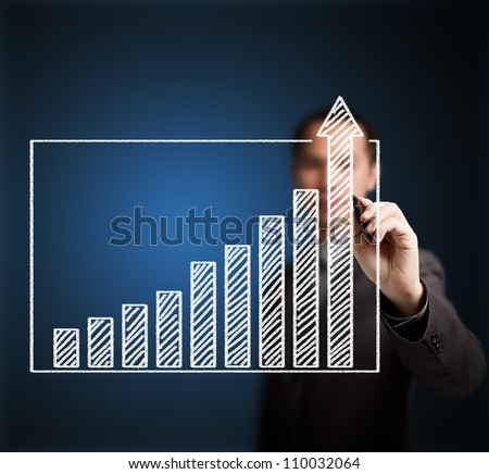 business man writing over achievement bar chart - stock photo
