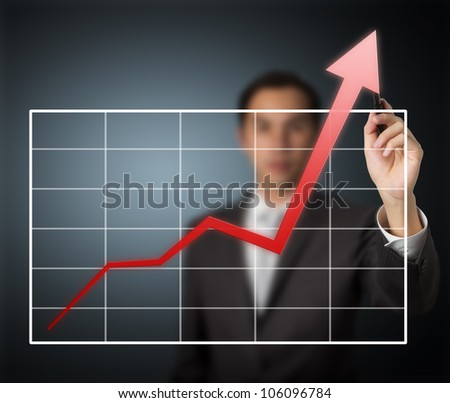 business man writing over achievement graph - stock photo