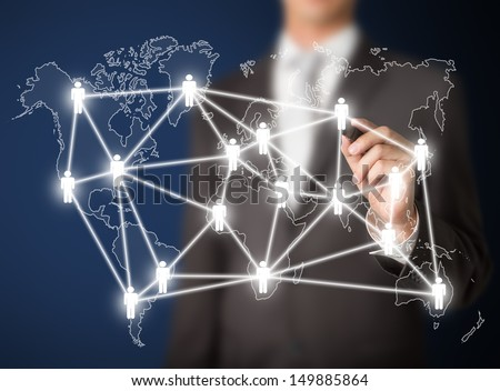 business man writing people management connection or global social network - stock photo