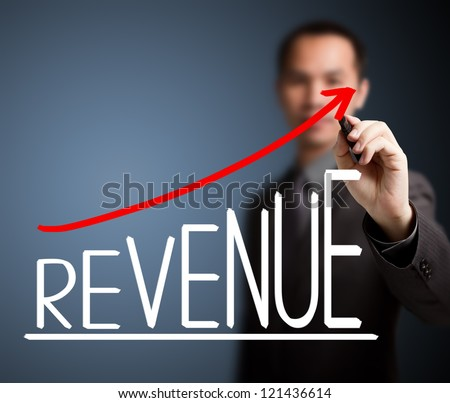 business man writing revenue growth graph