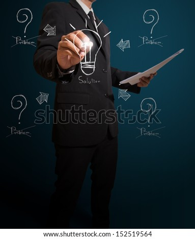 business man writing solution concept - stock photo