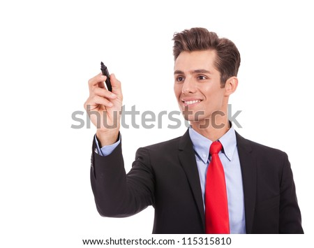 business man writing something on glass board with marker