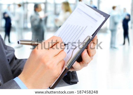 Business man writing something on the paper