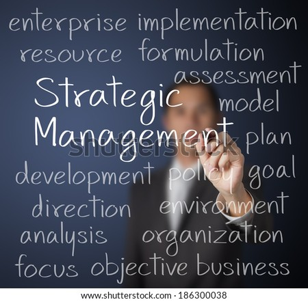 business man writing strategic management concept - stock photo