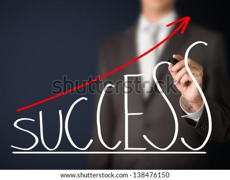 business man writing success graph - stock photo