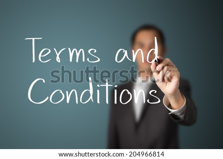business man writing terms and conditions - stock photo