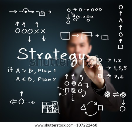business man writing various strategy model - stock photo